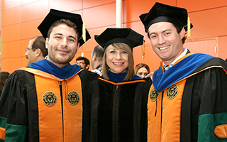 Students with Professor at Graduation